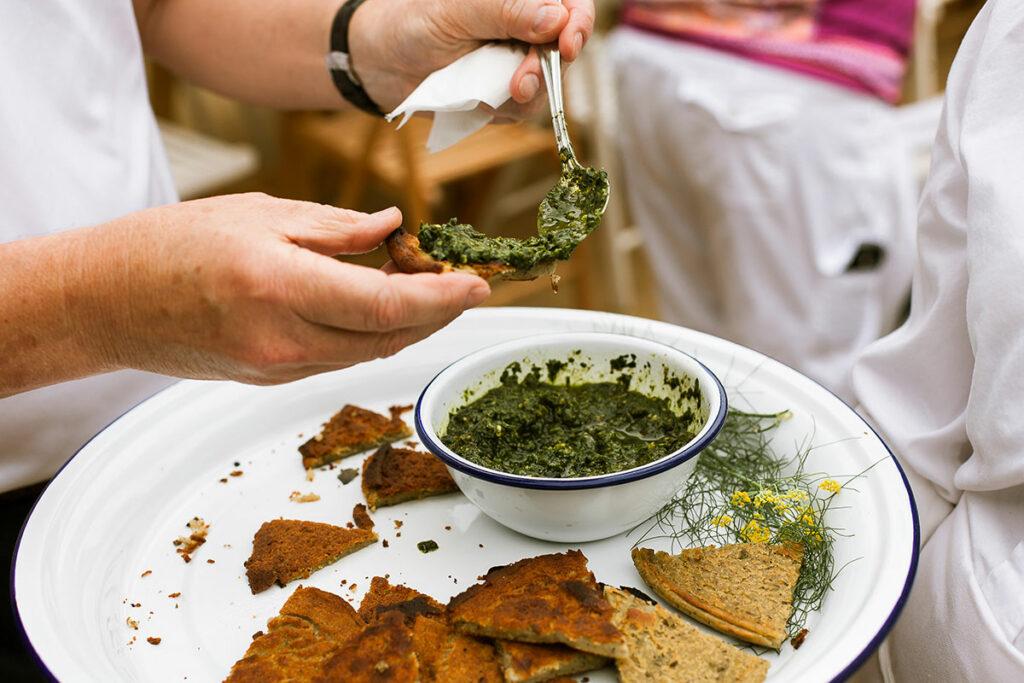 Fava Bean Farinata with pesto on a platter.