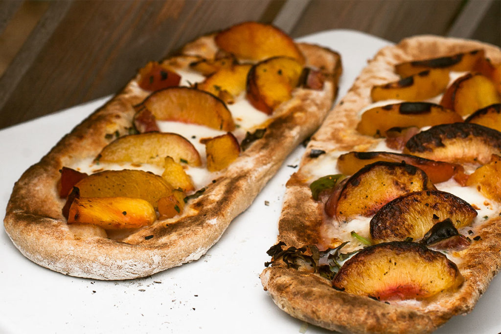 Grilled Peach Pizzas on a plate.