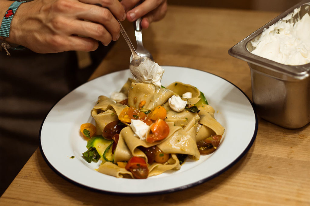 Herbed Pappardelle being served on a dish.