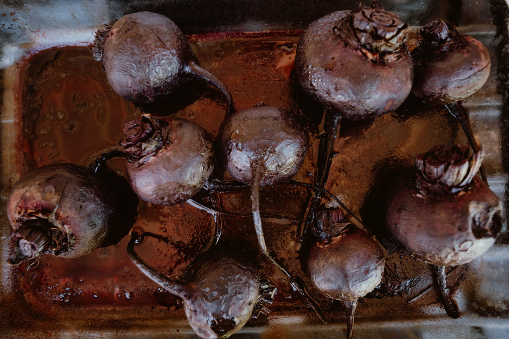 Beets in a baking dish after being roasted.
