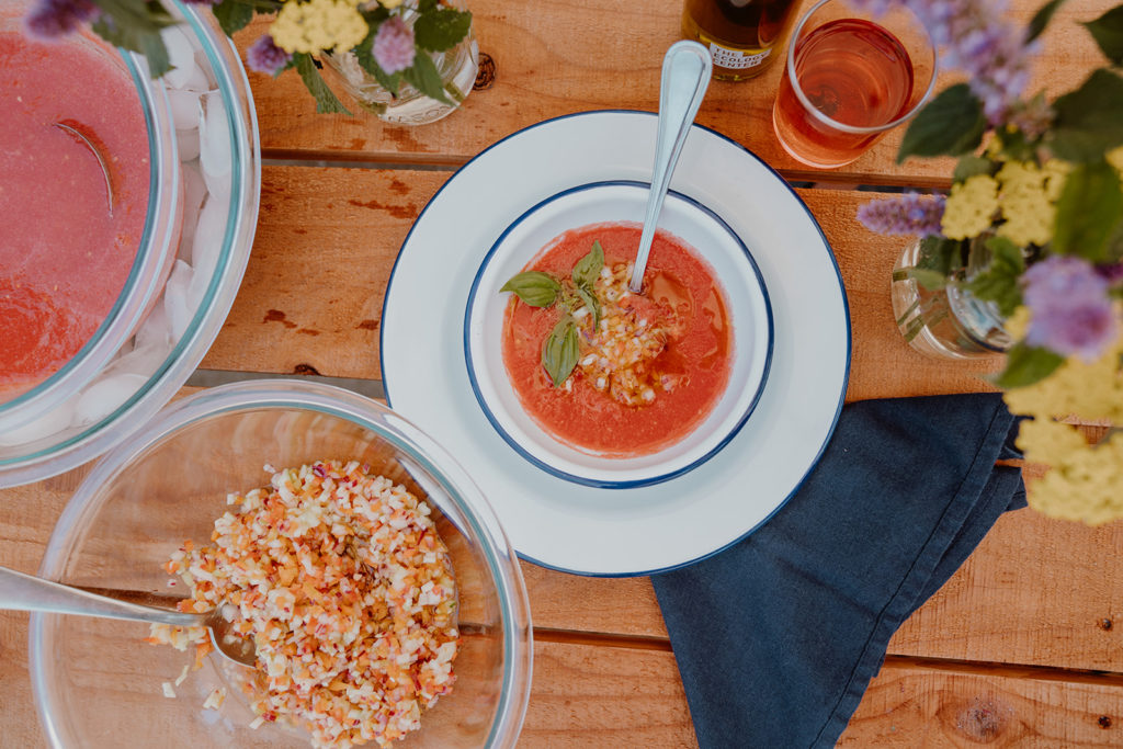 Aerial shot of gazpacho soup served in dish.