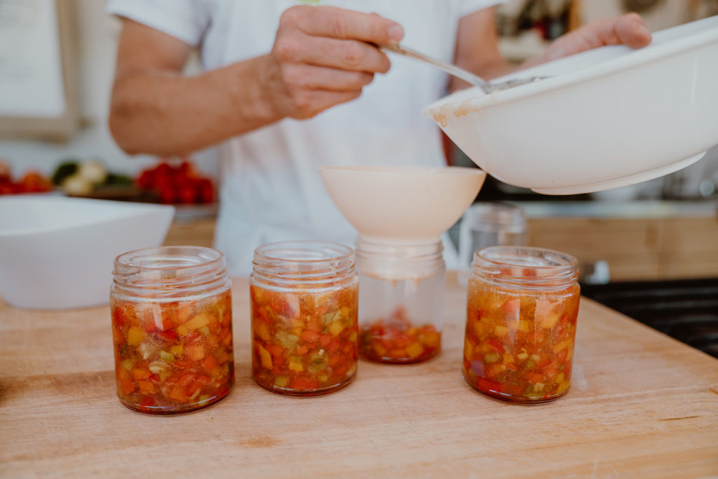 Hot Pepper Jelly being placed in jars.