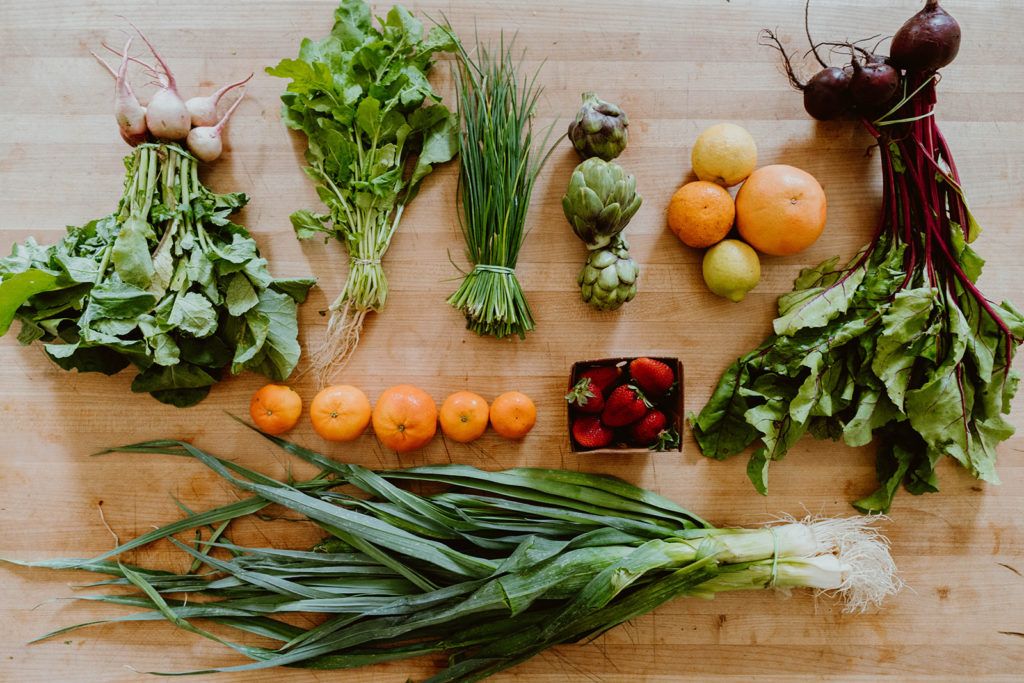 Top down shot of fresh organic produce on table.