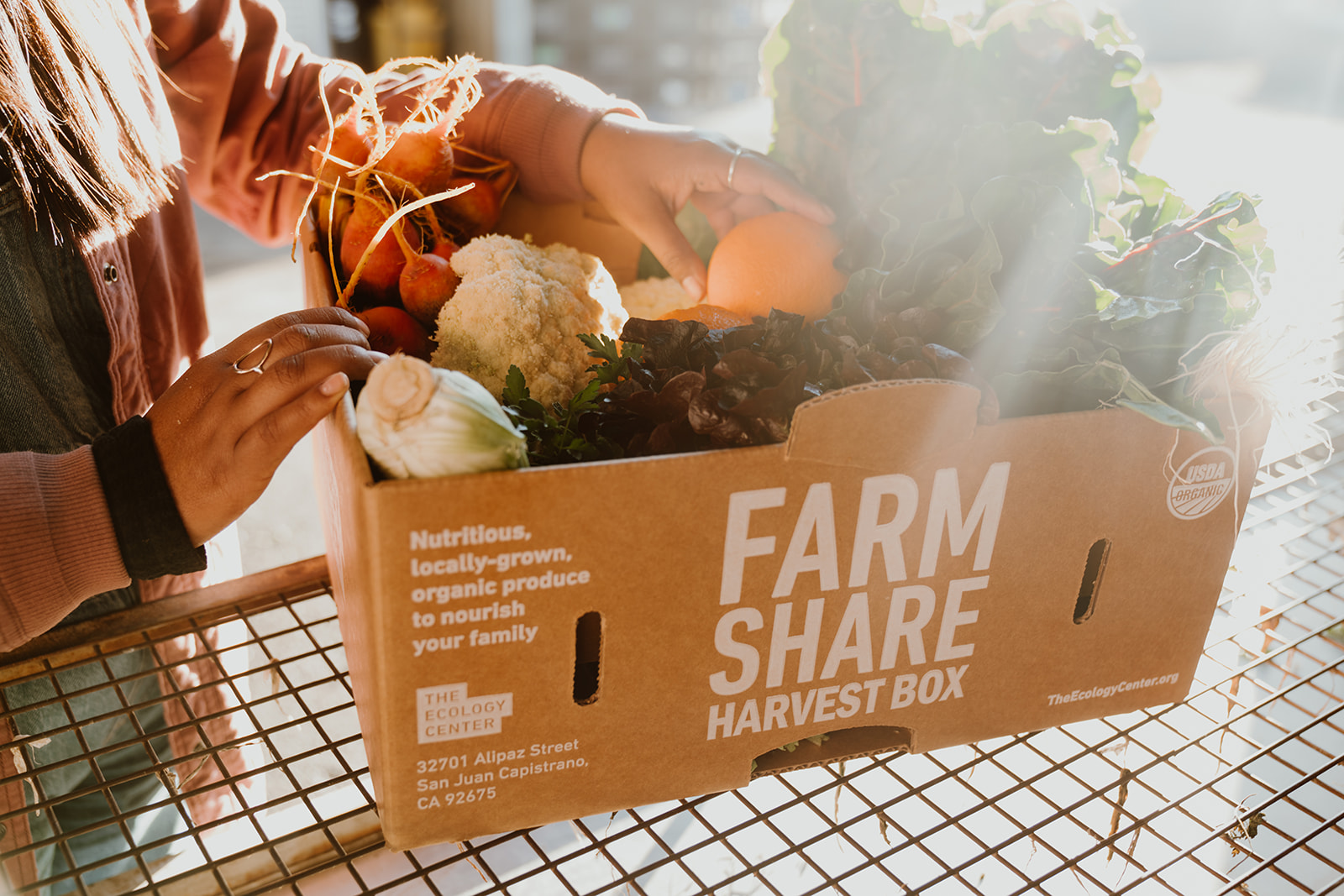 Farm Share Harvest Box being opened by member.