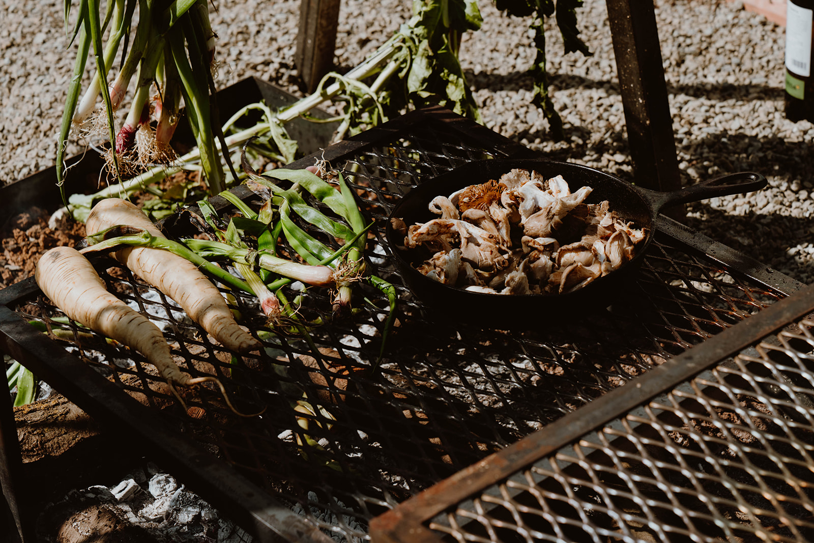 Open flame roasting of vegetables and mushrooms.