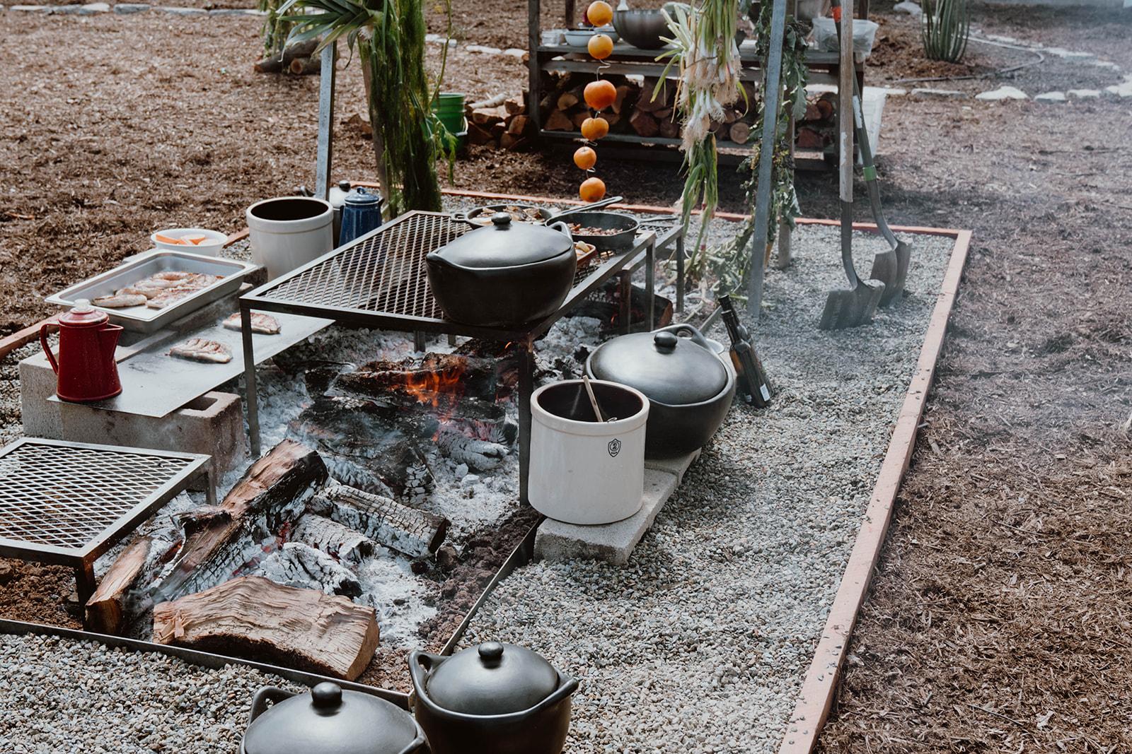 Outdoor fire burning kitchen.