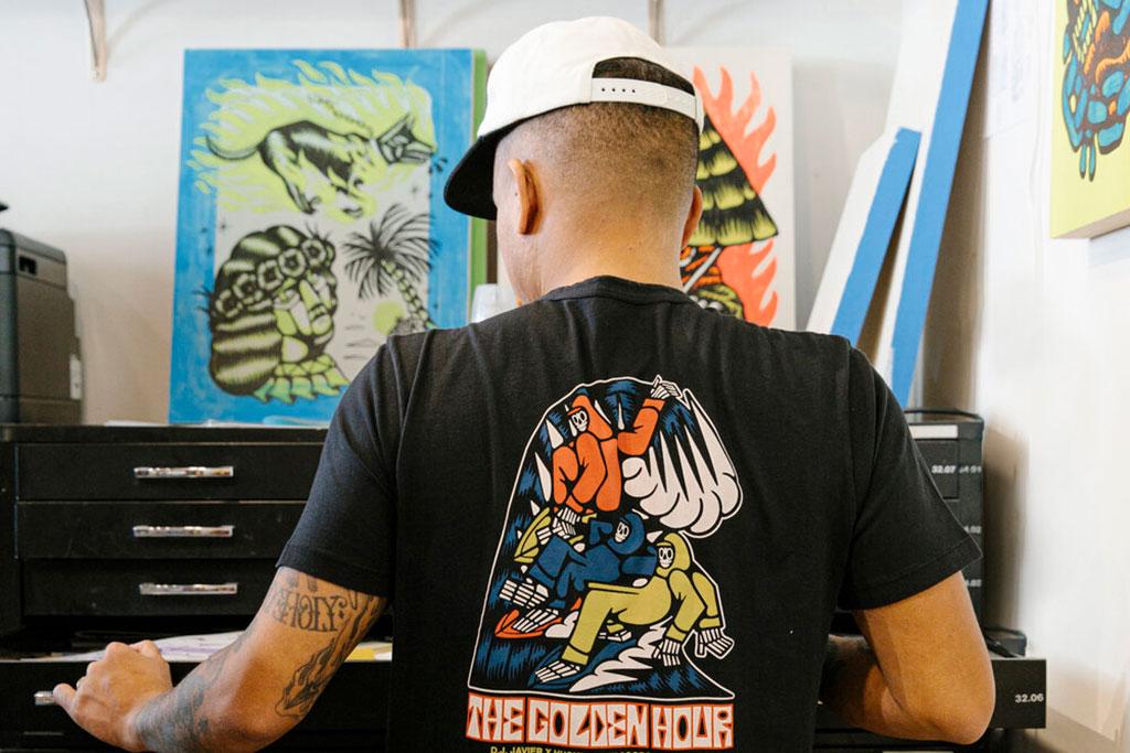 DJ Javier looking through art work.