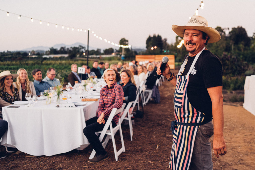 Chef Tim Byres speaking to dinner guests.